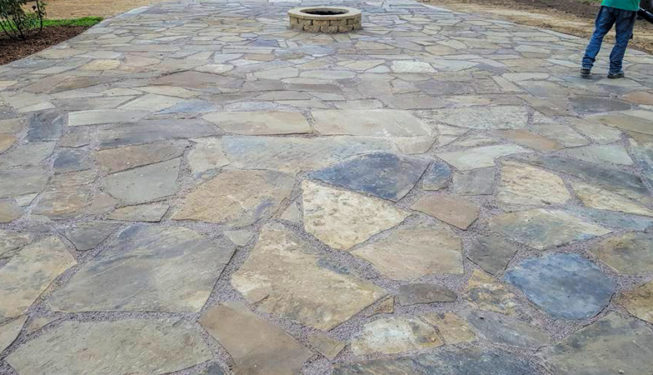 flagstone patio sitting area with fire-pit